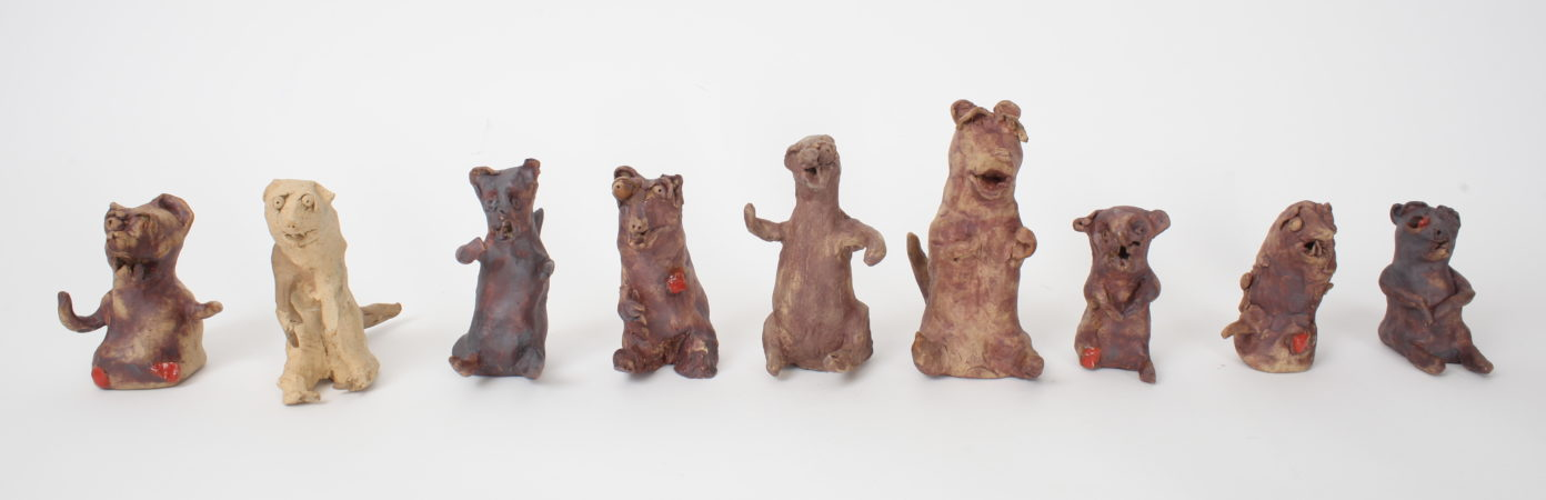 Dominic's ceramic Weasel Army continues to grow. He's been running workshops with HOME and Waterside (Sale) showing others how to make their own weasels, to add to the collection and eventually take over the world... (Image: 'Weasel Army', ceramic, 2019)