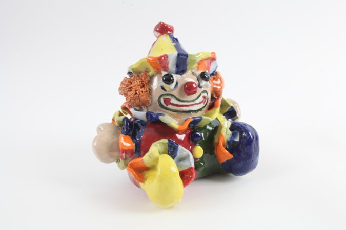 Lou has been producing impressively detailed and meticulous work in both ceramic and textile. (Image: 'Tommie the Clown', ceramic, 2019)
